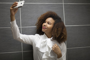 Professional woman taking a selfie