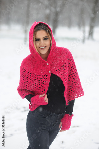 d6922f4a2fc5 Young happy girl in wool sweater and cap