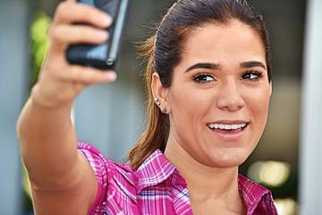 Selfie Of Diverse Woman Wearing Pink Shirt