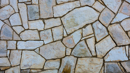 Grunge stone wall with irregular pattern- background or texture