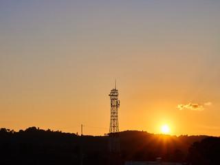 Sunrise with telecommunication tower