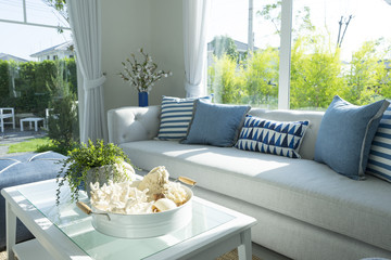 beach blue pillow on grey sofa in living room