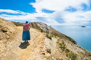 Local woman on Island of Sun on Titicaca lake, Bolivia