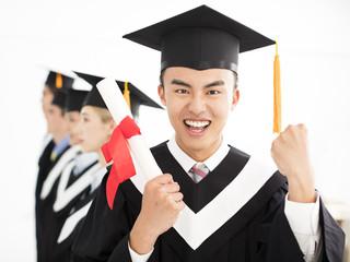 happy college graduate at graduation with classmates.