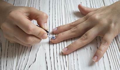 painting nail varnish, manicure. top view.