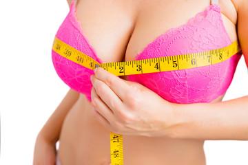 Woman taking her bra measurements