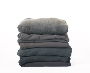 Stack of folded clothes. Colorful textile pile.