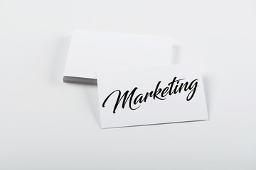 Business card concept with the word Marketing. Isolated. Mockup.