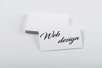 Business card concept with the words Web design. Isolated.
