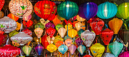 many colors of silk lanterns lit up at night