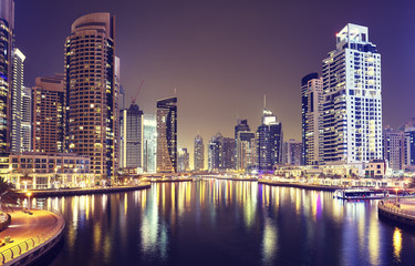 Dubai Marina at night, color toned picture, United Arab Emirates.