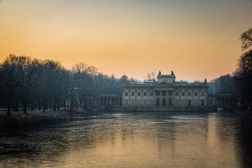 Sunrise over the Royal Palace on the Water in Lazienki Park  in Warsaw, Poland