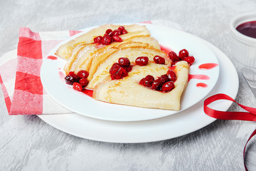 Russian pancakes with cornelian cherry jam.