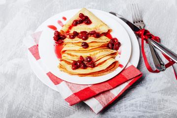 Russian pancakes with cornelian cherry jam