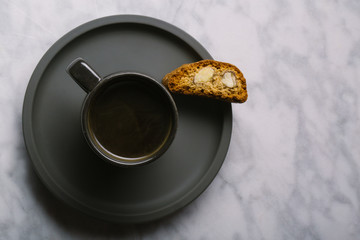 Close up of biscotti served with black coffee on table