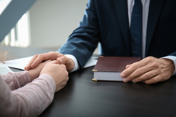 Lawyer having meeting with client in office, closeup