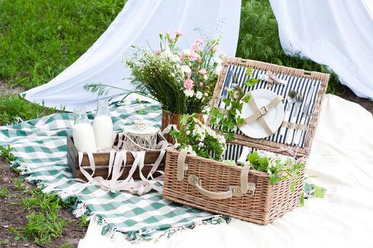 Picnic basket decorated with flowers outside