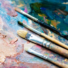 Paint brushes on an oil palette