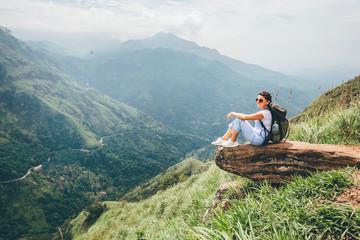 Tourist woman enjoy with beautiful view on mountains in Ella, Sri Lanka