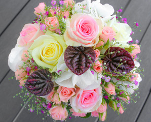Beautiful flower bunch with roses, gypsophila, violets and leaves, bridal bouquet
