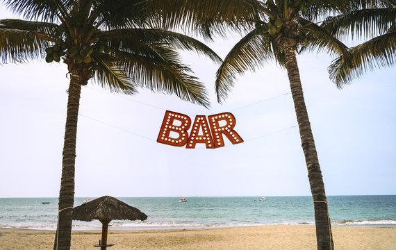 Bar sign between palms