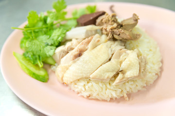 The steamed Hainanese chicken rice in Thai called khao Mun Kai delicious Asian food.