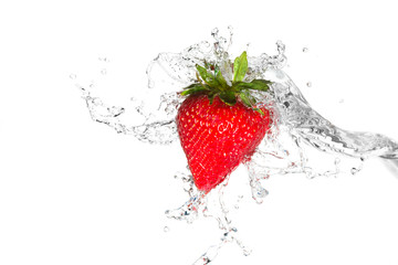 Water splashing on a strawberry against a white background