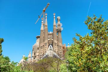 La Sagrada Familia - View to the facede of cathedral under bright sun, designed by Antonio Gaudi in Barcelona, Spain
