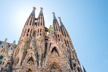 La Sagrada Familia - View to the facede of cathedral under bright sun, designed by Antonio Gaudi in Barcelona, Spain