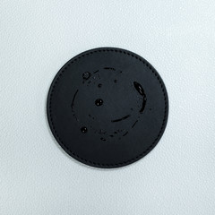 Water stain on black beverage coasters. Blank leather coasters for your design.
