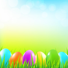 Easter background with grass and colorful eggs. Vector illustration.