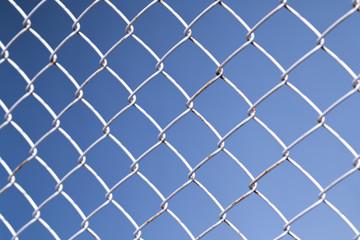 Iron net on blue background