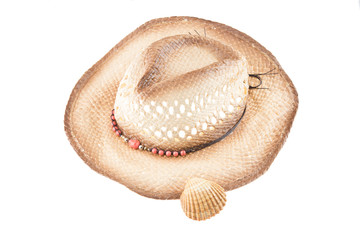 Women Straw hat isolated on white backround decorated with small shell