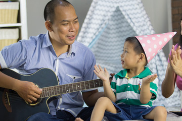 Playing music with son concept