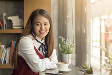 Beautiful woman sitting in a coffee shop