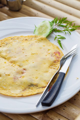 Cheese omelette with cucumber