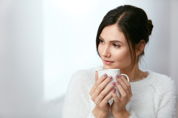 Drink. Beautiful Woman Drinking Tea From Cup