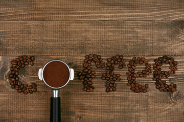 Word Coffee On Wooden Background