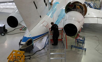 A technician works on a Bombardier Global aircraft at the company's service centre at Biggin Hill
