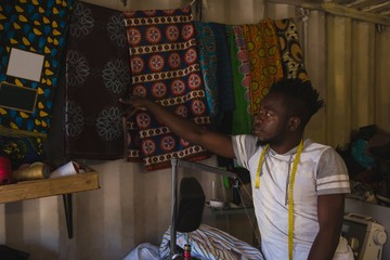 Tailor checking a blankets