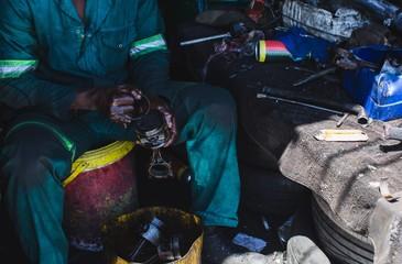 Mechanic repairing auto parts