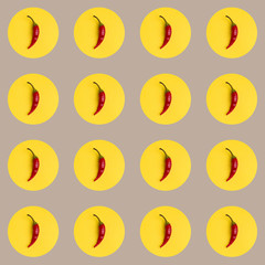 A repeating background of abstract red peppers.
