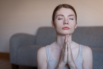 Young woman meditating with joined hands