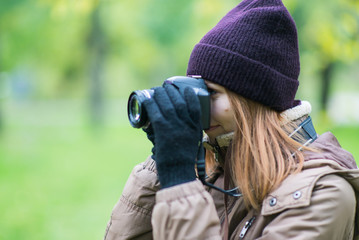 beautiful woman tourist travel photographer photographing forest at autumn day