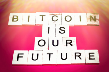 Wooden blocks on a red background spelling words Bitcoin is our Future