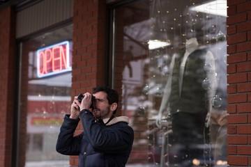 Man clicking photo with digital camera