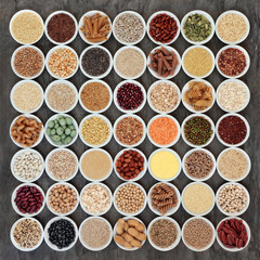 Macrobiotic health food selection of legumes, seeds, nuts, grains, cereals and whole wheat pasta with super foods high in protein, omega 3, anthocyanins, antioxidants, minerals and vitamins.