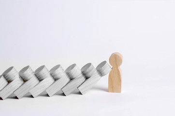 Man stops falling dominoes. Dominoes of people fall on one strong person. The concept of a bold, strong and decisive person. Strong business. Place for text.