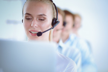 Attractive positive young businesspeople and colleagues in a call center office. Businesspeople