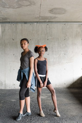 black sisters posing in dance position